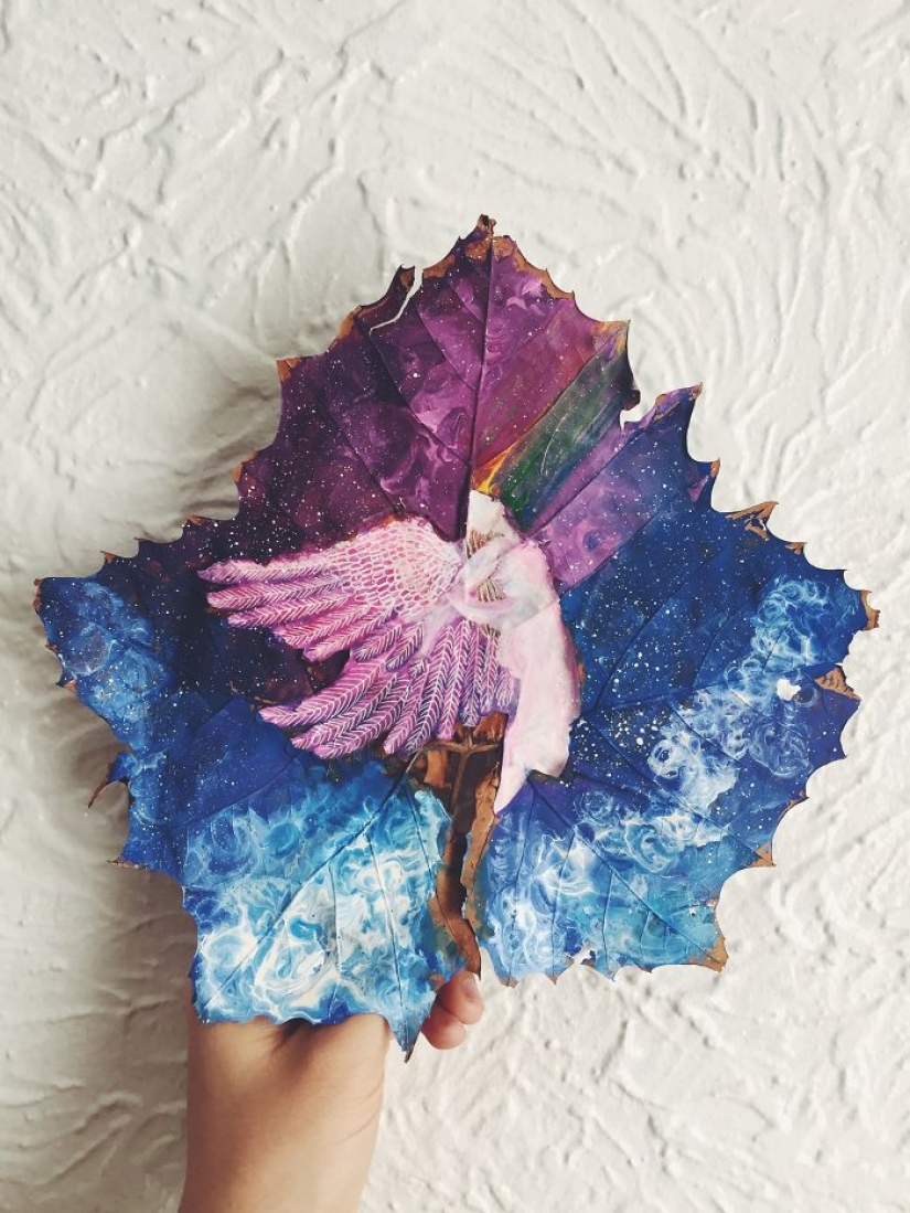 Fantasy worlds on a dry maple leaf