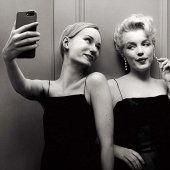 Hungarian photographer flora Borsi and her selfie with the stars of the past
