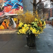 Crime or art? Someone is turning New York City trash cans into giant vases of flowers.